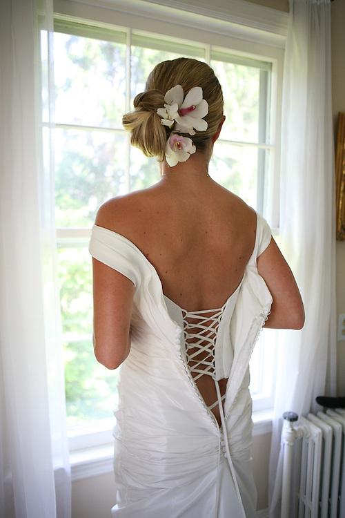 Bride getting into her Maggie Sottero gown