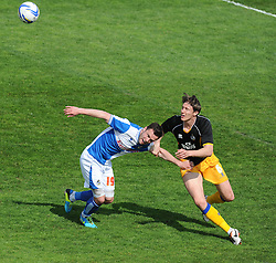 Bristol Rovers' Chris Beardsley shields the ball from Mansfield Town's Martin Riley- Photo mandatory by-line: Alex James/JMP - Mobile: 07966 386802 03/05/2014 - SPORT - FOOTBALL - Bristol - Memorial Stadium - Bristol Rovers v Mansfield - Sky Bet League Two