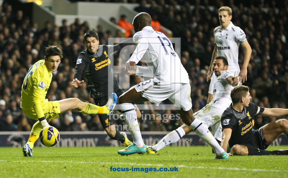 Picture by David Horn/Focus Images Ltd +44 7545 970036.28/11/2012.Hugo Lloris, William Gallas, Moussa Dembele and Michael Dawson of Tottenham Hotspur watch as Luis Suarez of Liverpool shoots wide during the Barclays Premier League match at White Hart Lane, London.