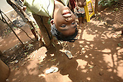 Budhia Singh, 6, the famous Limca World Record marathoner, is playing on a tree in front of his house inside Salia Sahi slum (pop. 30.000) of Bhubaneswar, the capital of Orissa State, on Friday, May 16, 2008. On May 1, 2006, Budhia completed a record breaking 65 km run from Jagannath temple, Puri to Bhubaneswar. He was accompanied by his coach Biranchi Das and by the Central Reserve Police Force (CRPF). On 8th May 2006, a Government statement had ordered that he stopped running. The announcement came after doctors found the boy had high blood pressure and cardiological stress. As of 13th August 2007 Budhia's coach Biranchi Das was arrested by Indian police on suspicion of torture. Singh has accused his coach of beating him and withholding food. Das says Singh's family are making up charges as a result of a few petty rows. On April 13, Biranchi Das was shot dead in Bhubaneswar, in what is believed to be an event unconnected with Budhia, although the police is investigating the case and has made an arrest, a local goon named Raja Archary, which is now in police custody. **Italy and China Out**