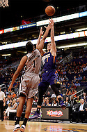 Oct 16, 2014; Phoenix, AZ, USA; Phoenix Suns guard Goran Dragic (1) puts up a shot against the San Antonio Spurs guard Kyle Anderson (1) in the first half at US Airways Center. Mandatory Credit: Jennifer Stewart-USA TODAY Sports