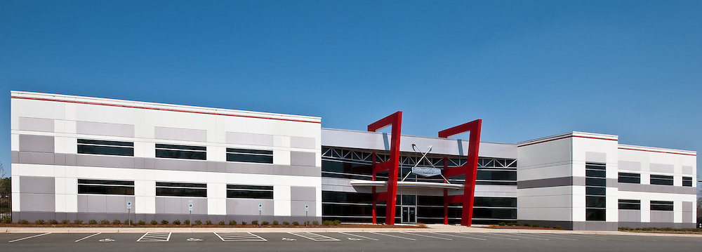 Architectural Photograph of NASCAR racing team Stewart Hass Racing shop and headquarters. Stewart-Haas Racing<br />