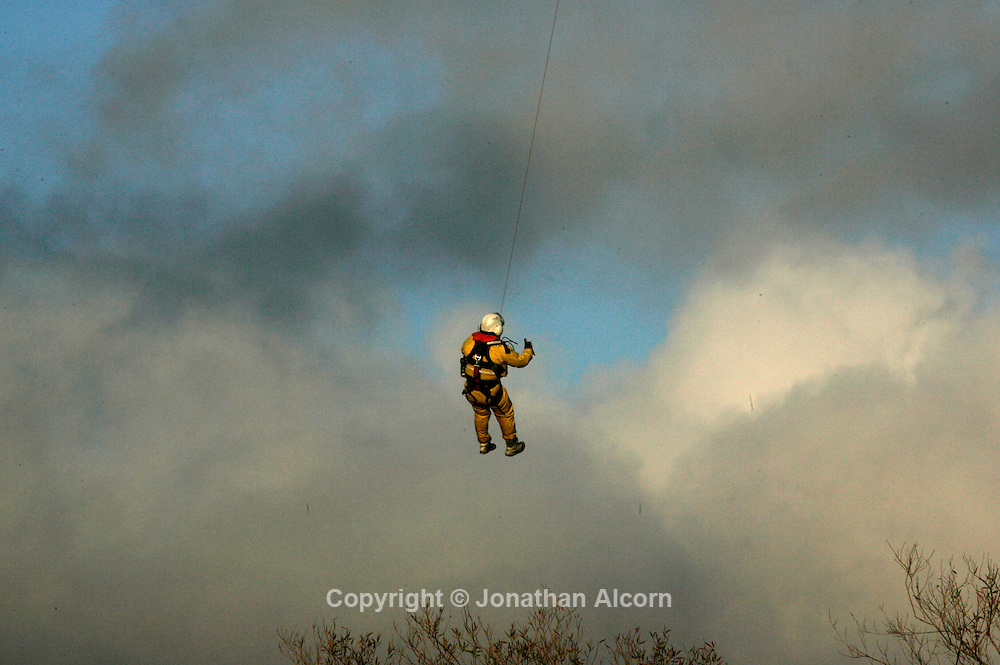 Jan 18, 2010 - Los Angeles, California, USA - Los Angeles Fire Department Rescue Crews search for a homeless person reportedly missing in rain-swollen Tujunga Wash in Sunland section of Los Angeles,