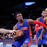 10 March 2015: Detroit Pistons guard Reggie Jackson (1) drives past Los Angeles Lakers center Jordan Hill (27) and Los Angeles Lakers forward Carlos Boozer (5) during the Los Angeles Lakers 93-85 victory over the Detroit Pistons, at the Staples Center, Los Angeles, California, USA.