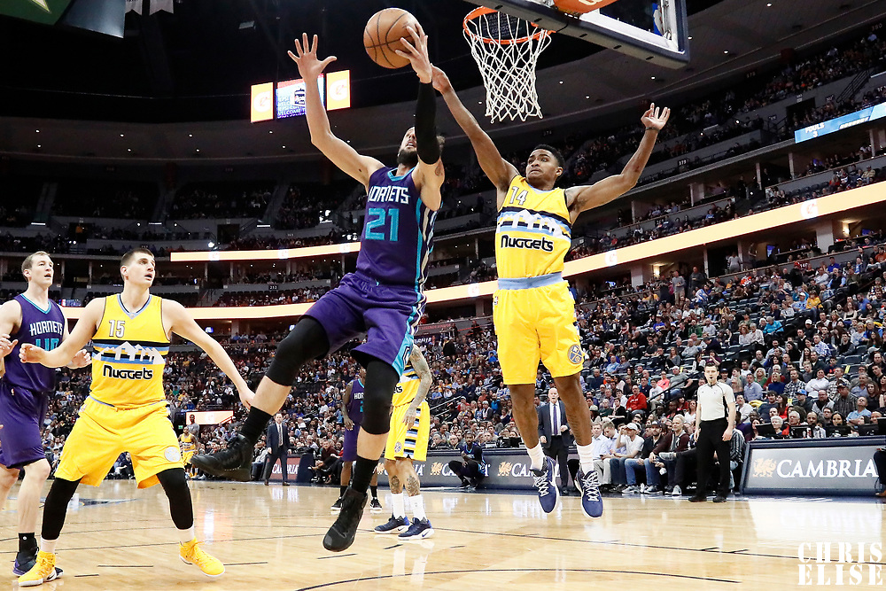 04 March 2017: Charlotte Hornets guard Marco Belinelli (21) reaches for the ball next to Denver Nuggets guard Gary Harris (14) during the Charlotte Hornets 112-102 victory over the Denver Nuggets, at the Pepsi Center, Denver, Colorado, USA.