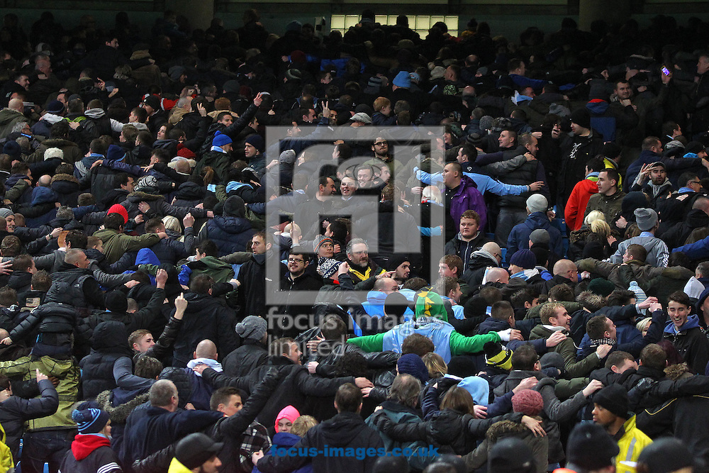 Picture by Paul Chesterton/Focus Images Ltd +44 7904 640267<br /> 08/01/2014<br /> The Man City fans show the West Ham fans how to do the &quot;Poznan&quot; during the Capital One Cup Semi Final 1st Leg match at the Etihad Stadium, Manchester.