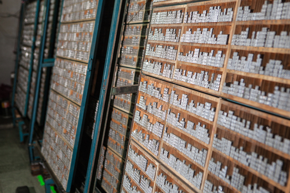 Lead type in traditional Chinese characters stacked on shelves at the rixing Type Foundry.