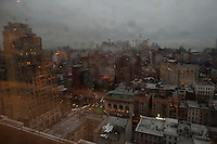 Rainy day lower Manhattan taken from LiveStream.com offices at 14th Street and 8th Ave in New York City. 1 World Trade Center is seen in the distance under construction...Photo by Robert Caplin.