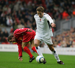 LIVERPOOL, ENGLAND - SUNDAY MARCH 27th 2005: Celebrity XI's Marcus Patrick beats Liverpool Legends' Paul Walsh during the Tsunami Soccer Aid match at Anfield. (Pic by David Rawcliffe/Propaganda)