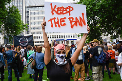 "© Licensed to London News Pictures. 29/05/2017. London UK. A demonstrator holds a sign aloft at an ""Anti-Hunting March"" in central London, marching from Cavendish Square to outside Downing Street.  Protesters are demanding that the ban on fox hunting remains, contrary to reported comments by Theresa May, Prime Minister, that the 2004 Hunting Act could be repealed after the General Election.<br />  Photo credit : Stephen Chung/LNP"