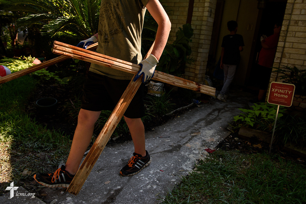 Caeden Wisdom, a volunteer from Memorial Lutheran Church, Katy, Texas, hauls debris from a home damaged by Hurricane Harvey on Friday, Sept. 1, 2017, in Katy.  LCMS Communications/Erik M. Lunsford