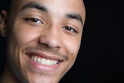 Teenage boy smiling,