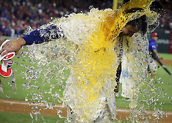 May 12, 2017 - Arlington, TX, USA - Texas Rangers' Joey Gallo (13) gets showered in powerade by Elvis Andrus after a game-winning three-run home run in the ninth inning to beat the Oakland Athletics 5-2 on Friday, May 12, 2017 at Globe Life Park in Arlington, Texas. (Credit Image: © Richard W. Rodriguez/TNS via ZUMA Wire)