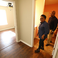 Patrenia Miller and her husband, Reggie, tour the Habitat for Humanity home that was dedicated to new home owner Daphne Waldrop, Monday afternoon in Verona. Reggie, a cousin of Waldrop's, came to see the home and support his family member during the dedication ceremony.