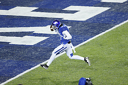 Kentucky safety Mike Edwards intercepts a pass and returns it for a touchdown in the second half.<br /> The University of Kentucky hosted Charlotte, Saturday, Nov. 21, 2015 at Rupp Arena in Lexington.