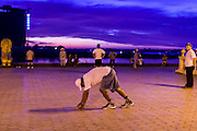 29 JUNE 2013 - PHNOM PENH, CAMBODIA: People stretch and exercise in the early morning hours on Sisowath Quay in Phnom Penh.       PHOTO BY JACK KURTZ