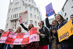 London, UK. 19th January, 2019. Thousands of women prepare to take part in the Global Women's March from BBC Broadcasting House to Trafalgar Square to attend a Bread & Roses Rally Against Austerity organised by Women's March London. Inspired by the 1912 Bread & Roses protests which revolutionised workers' rights for women and in the light of Brexit, the organisers called for assurances from the Government in ending policies of austerity which lead to economic oppression, violence against women, the gender pay gap, racism, fascism, institutional sexual harassment and the hostile environment experienced by marginalised groups.