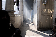 "A small drug community spends his time in the landing of a building before and after consumption of hashish and heroin. Shan Nazar Kapull, Rawalpindi, Pakistan, on thursday, November 27 2008.....""Pakistan is one of the countries hardest hits by the narcotics abuse into the world, during the last years it is facing a dramatic crisis as it regards the heroin consumption. The Unodc (United Nations Office on Drugs and Crime) has reported a conspicuous decline in heroin production in Southeast Asia, while damage to a big expansion in Southwest Asia. Pakistan falls under the Golden Crescent, which is one of the two major illicit opium producing centres in Asia, situated in the mountain area at the borderline between Iran, Afghanistan and Pakistan itself. .During the last 20 years drug trafficking is flourishing in the Country. It is the key transit point for Afghan drugs, including heroin, opium, morphine, and hashish, bound for Western countries, the Arab states of the Persian Gulf and Africa..Hashish and heroin seem to be the preferred drugs prevalence among males in the age bracket of 15-45 years, women comprise only 3%. More then 5% of whole country's population (constituted by around 170 milion individuals),  are regular heroin users, this abuse is conspicuous as more of an urban phenomenon. The substance is usually smoked or the smoke is inhaled, while small number of injection cases have begun to emerge in some few areas..Statistics say, drug addicts have six years of education. Heroin has been identified as the drug predominantly responsible for creating unrest in the society."""