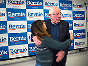 06 DECEMBER 2019 - DES MOINES, IOWA: A volunteer hugs US Senator BERNIE SANDERS (I-VT) during a volunteer training session in Des Moines Friday. As the date of the Iowa caucuses approaches, many of the campaigns are ramping up their voter outreach efforts. The event was part of Sanders' campaign to be the Democratic presidential nominee in 2020. Iowa hosts the first selection event of the presidential election cycle. The Iowa Caucuses are Feb. 3, 2020.   PHOTO BY JACK KURTZ