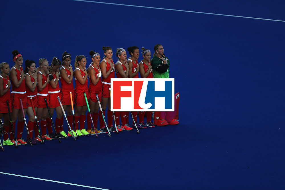 RIO DE JANEIRO, BRAZIL - AUGUST 06:  Team United States liines up for the national anthem prior to a Women's Pool B match between the United States and Argentina on Day 1 of the Rio 2016 Olympic Games at the Olympic Hockey Centre on August 6, 2016 in Rio de Janeiro, Brazil.  (Photo by Sean M. Haffey/Getty Images)