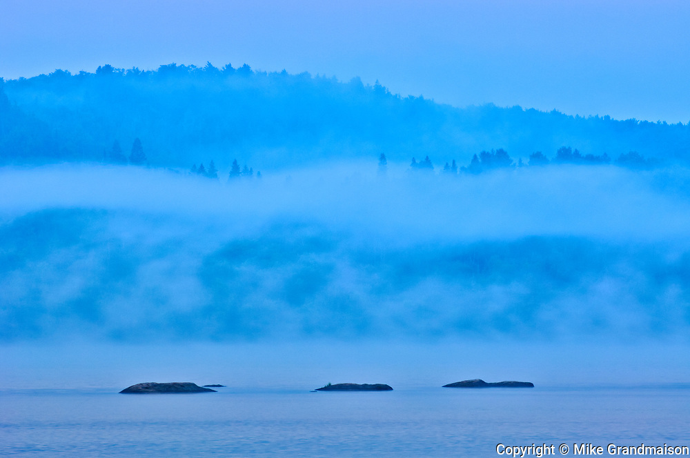 Fog at dawn on Lake of Two Rivers, Algonquin Provincial Park, Ontario, Canada