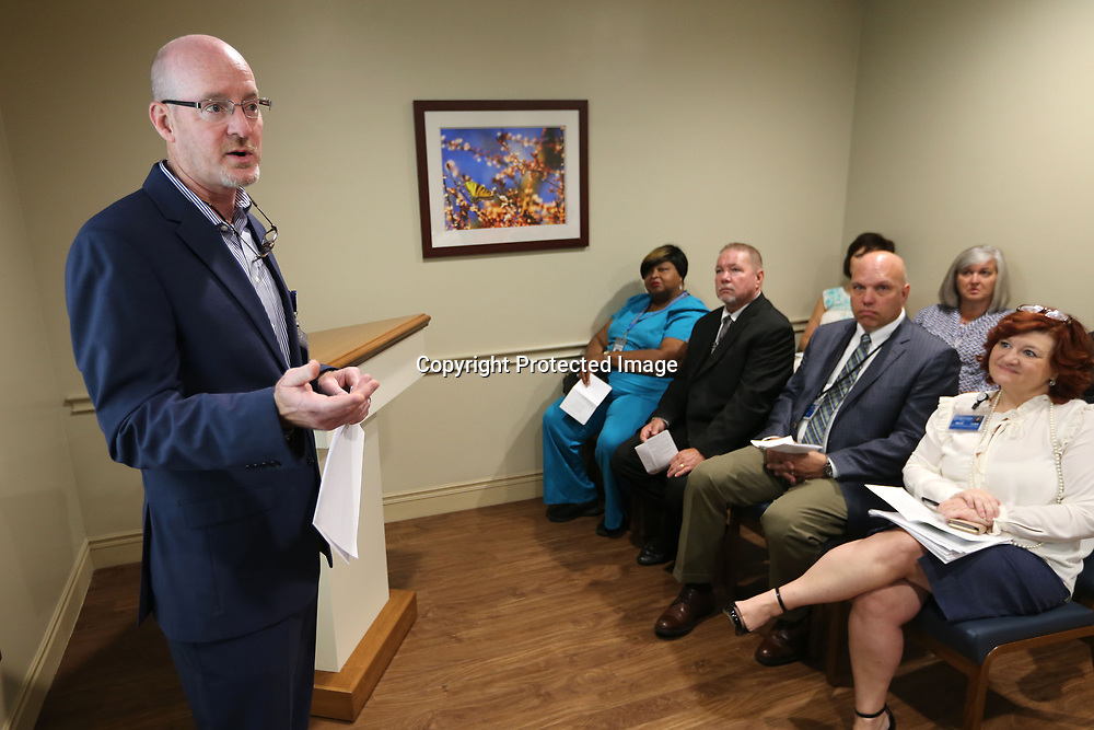 David Wilson, President of North Mississippi Medical Center, speaks to those that attended the dedication of the newly renovated chapel and meditation room at the North Mississippi Medical Center Wednesday morning. The work was made possible through a gift from the Auxiliary of North Mississippi Medical Center.