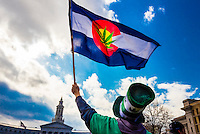 Man waving Colorado flag with Marijuana leaf at the center, 420 Cannabis Culture Music Festival, Civic Center Park, Downtown Denver, Colorado USA. This is the largest marijuana rally in the world.