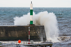 © Licensed to London News Pictures. 21/09/2018. Aberystwyth, UK. At first light, and with the high tide, the gale force winds of Storm Bronagh, the second named storm of the UK winter, brings waves crashing against the harbour lighthouse in Aberystwyth .Photo credit: Keith Morris/LNP