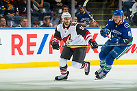 KELOWNA, BC - SEPTEMBER 29: Jake Virtanen #18 of the Vancouver Canucks stick checks Alex Goligoski #33 of the Arizona Coyotes  at Prospera Place on September 29, 2018 in Kelowna, Canada. (Photo by Marissa Baecker/NHLI via Getty Images)  *** Local Caption *** Jake Virtanen;Alex Goligoski