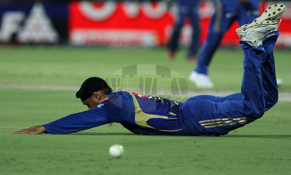 Mumbai Indian captain Harbhajan Singh dives to stop the ball during match 72 of the Indian Premier League ( IPL) 2012  between The Rajasthan Royals and the Mumbai Indians  held at the Sawai Mansingh Stadium in Jaipur on the 20th May2012..Photo by Vipin Pawar/IPL/SPORTZPICS