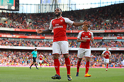 Arsneal's Alexandre Lacazette celebrates scoring his side's first goal of the game during the Emirates Cup match at the Emirates Stadium, London.