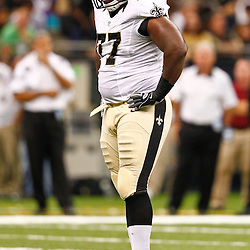 August 17, 2012; New Orleans, LA, USA; New Orleans Saints defensive tackle Brodrick Bunkley (77) against the Jacksonville Jaguars during the first half of a preseason game at the Mercedes-Benz Superdome. Mandatory Credit: Derick E. Hingle-US PRESSWIRE