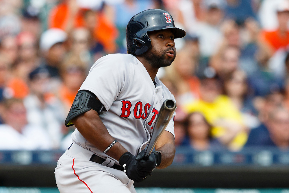 Aug 9, 2015; Detroit, MI, USA; Boston Red Sox center fielder Jackie Bradley Jr. (25) hits a three RBI triple in the eighth inning against the Detroit Tigers at Comerica Park. Mandatory Credit: Rick Osentoski-USA TODAY Sports