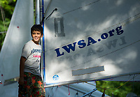 Aidan Ocampo rigs up his sail and looks to the open water just prior to launching his Opti for the annual Lake Winnipesaukee Sailing Assocation's youth regatta Thursday morning.  (Karen Bobotas/for the Laconia Daily Sun)