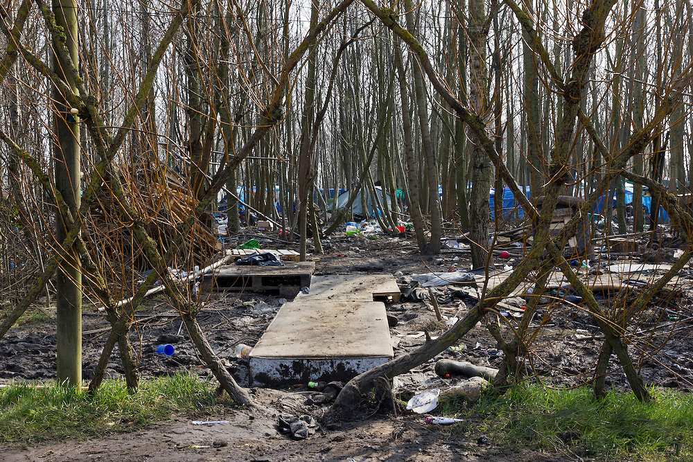 On the outskirts of Dunkirk in Northern France, opposite a relatively new housing estate and yards away from a modern garden center and outdoor clothing retailer Decathlon, sits the isolated and solitary remains of France&rsquo;s &lsquo;forgotten migrant camp&rsquo; -- Grande-Synthe.<br />