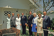 Presidential couples pose in front of the Nixon birthplace at the opening of the Nixon Library on July 19, 1990...Photograph by Dennis Brack bb24