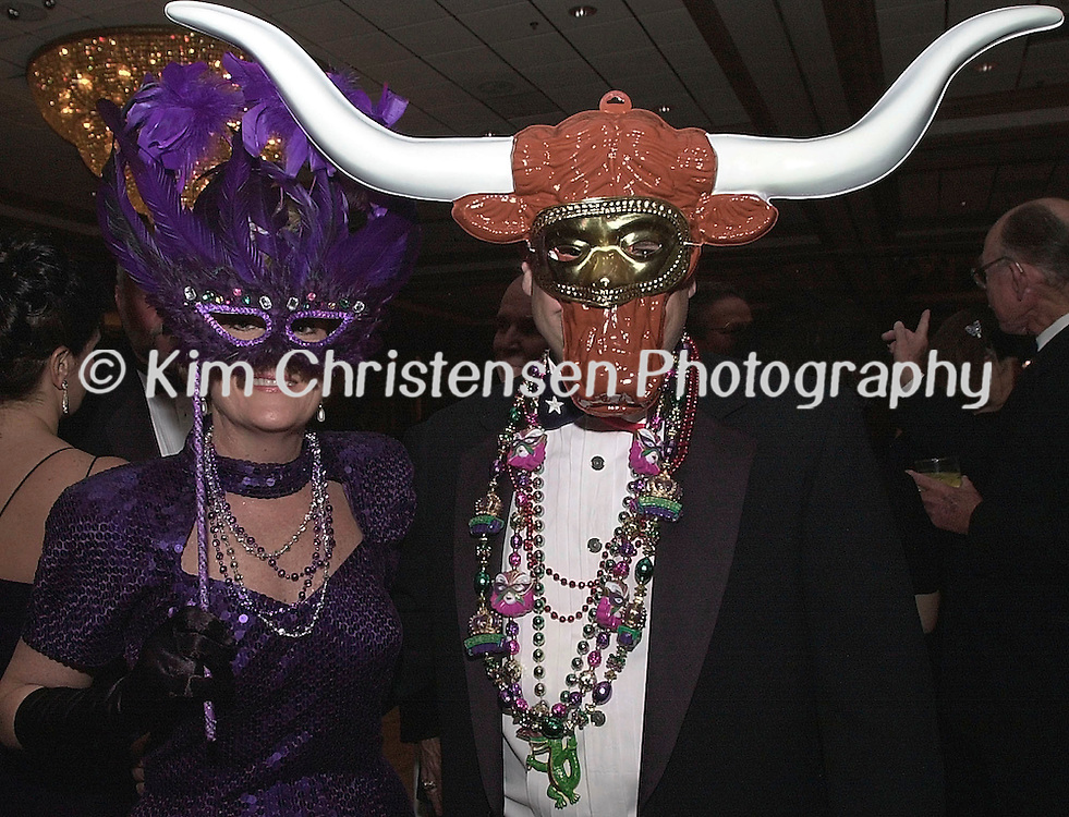 KIM CHRISTENSEN/For The Daily News .Krewe of Gambrinus 2 KC.Deborah and Bartt Thompson of Houston dress to attend the Krewe of Grambrinus Ball at the San Luis Resort Ballroom in Galveston Saturday night.