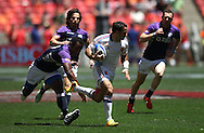 Julien Candelon of France heads to the try line during the match between France and Scotland of the HSBC Sevens World Series Port Elizabeth Leg held at the Nelson Mandela Bay Stadium on 7th December 2013 in Port Elizabeth, South Africa. Photo by Shaun Roy