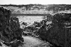 Bridge at the waterfalls Hraunfossar in Borgarfjordur, Iceland - Brú við hraunfossa í Borgarfirði