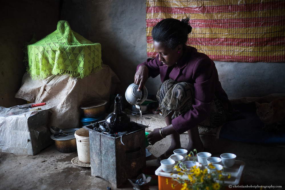Beles Sunrise project BSP, water harvesting & irrigation. , Bernan Alem (f, 22), prepare coffee in the early morning.