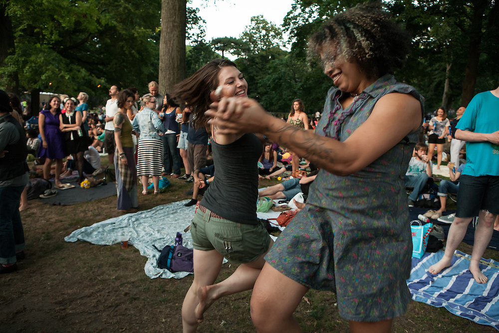 Two women dance to the music of The Devil Makes Three at Celebrate Brooklyn.