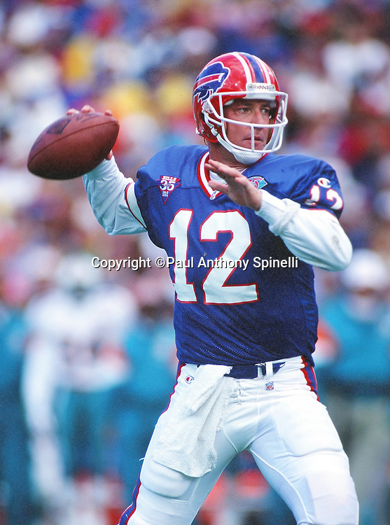 Buffalo Bills quarterback Jim Kelly (12) throws a pass during the NFL football game against the Miami Dolphins on Oct. 9, 1994 in Orchard Park, N.Y. The Bills won the game 21-11. (©Paul Anthony Spinelli)