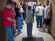 "03 JUNE 2011 - SPRINGERVILLE, AZ: People stood in the hallways to hear what was said at the community meeting at Round Valley Middle School in Eager Friday. High winds and temperatures have continued to complicate firefighters' efforts to get the Wallow fire under control. The  mandatory evacuation order for Alpine was extended to Nutrioso, about 10 miles north of Alpine and early Friday morning fire was reported on the south side of Nutrioso. The fire grew to more than 106,000 acres early Friday with zero containment. A ""Type I"" incident command team has been called in to manage the fire.    PHOTO BY JACK KURTZ"