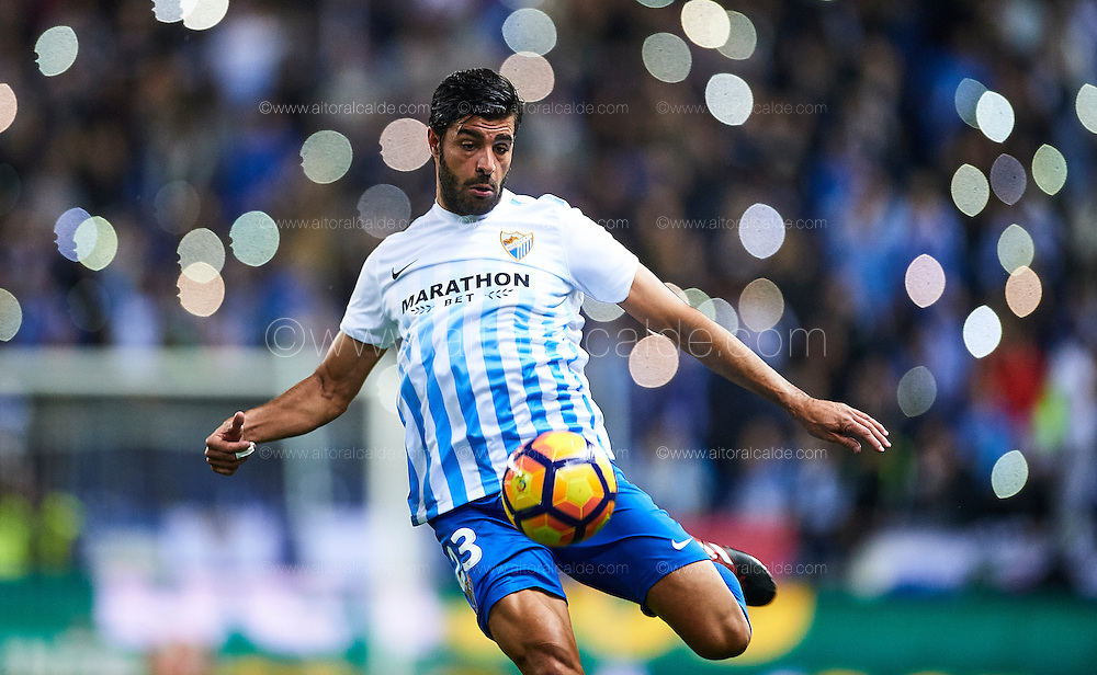 MALAGA, SPAIN - DECEMBER 09:  Miguel Torres of Malaga CF in action during La Liga match between Malaga CF and Granada CF at La Rosaleda Stadium December 9, 2016 in Malaga, Spain.  (Photo by Aitor Alcalde Colomer/Getty Images)