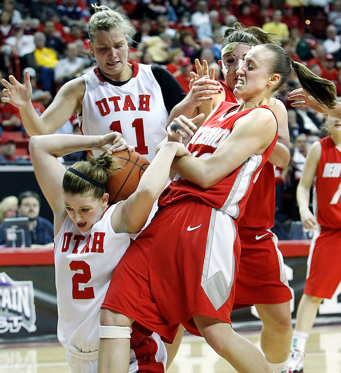Utah forward Kalee Whipple fights for control of the ball with New Mexico guard Sara Halasz  as Utah forward Taryn Wicijowski looks on (back left) the University of Utah women's basketball defeated New Mexico in overtime to advance in the Mountain West Conference basketball Championship Tournament at the Thomas & Mack Center in Las Vegas, Nevada Wednesday, March 10, 2010.  August Miller, Deseret News .