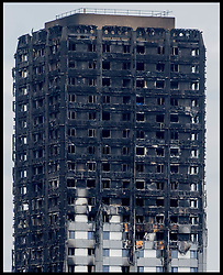 June 22, 2017 - London, London, United Kingdom - General View of the Grenfell Town in West London, Which caught fire on June 14th, where Seventy-nine people are believed to have died after a huge fire engulfed a west London tower block. Theresa May announced today that there could be six hundred  high-rise buildings that have cladding similar to Grenfell Tower as Theresa May reveals panels on three blocks have already been assessed as 'combustible'  (Credit Image: © Andrew Parsons/i-Images via ZUMA Press)