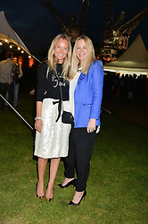 Left to right, MARTHA WARD and ASTRID HARBORD at the Battersea Power Station Annual Party at Battersea Power Station, 188 Kirtling Street, London SW8 on 30th April 2014.