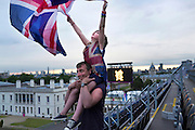 A father and daughter celebrate Great Britain winning gold in the Paralympic equestrian at Greenwich Park