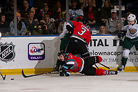 KELOWNA, BC - SEPTEMBER 28:  forward Jake Poole #23 of the Kelowna Rockets falls to the ice during first period against the Everett Silvertips at Prospera Place on September 28, 2019 in Kelowna, Canada. (Photo by Marissa Baecker/Shoot the Breeze)