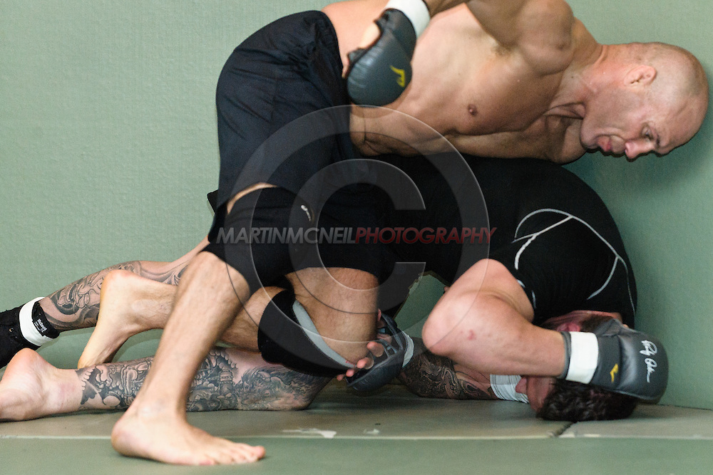 Randy Couture (top) and Neil Melanson train grappling drills during a pre-fight training session at Straight Blast Gym ahead of UFC 105 in Manchester, England on November 12, 2009.